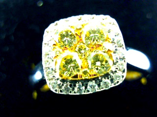 1/2ctw 14k white gold yellow & white diamond ring.